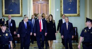 Senate majority leader Mitch McConnell escorts US president-elect Donald Trump and  his wife Melania Trump to a meeting at the  Capitol in Washington. Photograph: Pete Marovich/Bloomberg