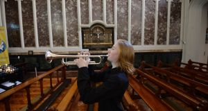 Trumpet player Donncha McDonagh practising in St Mary's Church, Haddington Road, Dublin, ahead of  the Lassus choir's Remembrance Day performance on Friday night. Photograph: Alan Betson