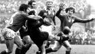 New Zealand scrumhalf Sid Going gets in his kick despite the attentions of Ireland's Sean Lynch and Fergus Slattery during the 1973 game which ended  10-10. Photograph:   Dermot O'Shea