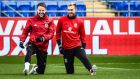 Wales' Chris Gunter  and Aaron Ramsey stretch out during a training session at Cardiff City Stadium on Friday ahead of the World Cup qualifier against Serbia.  Photograph: Ben Birchall/PA Wire