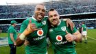 Simon Zebo and Cian Healy after Ireland's historic win in Soldier Field. Photograph: Billy Stickland