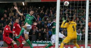 Northern Ireland's Gareth McAuley heads home their  second goal  in the  World Cup qualifier against Azerbaijan   at Windsor Park. Photograph:   Brian Lawless/PA Wire