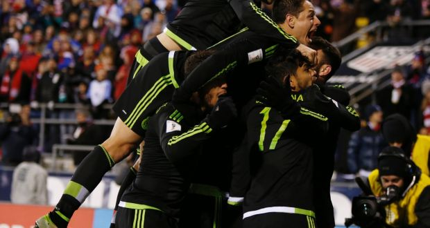 551d21cc1ff Mexico players celebrate Rafael Marquez s goal against the USA during the  2018 FIFA World Cup qualifying