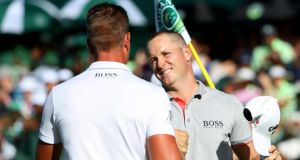 Alex Noren of Sweden is congratulated by compatriot Henrik Stenson after his victory in Sun City. Photograph: Getty