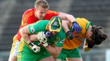 Corofin's goalkeeper Bernard Power and Kieran Molloy clash with Danny Kirby of Castlebar during the Connacht club championship semi-final. Photo: Dan Sheridan/Inpho