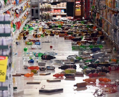 SUPERMARKET SHAKEN: Groceries litter the ground at the New World Supermarket in Miramar after a 7.8 magnitude earthquake near Cheviot in the South Island hit New Zealand, triggering a tsunami warning. Photograph: Ross Setford/EPA