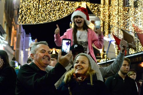 FESTIVE FUN: Dave and Liz Lynch from Finglas (at front) soak up the atmosphere as the Christmas lights are switched on at Grafton Street in Dublin.   Photograph: Cyril Byrne/The Irish Times
