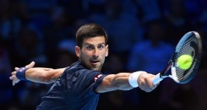 Novak Djokovic returns the ball to  Dominic Thiem during their singles group match of the ATP World Tour Finals. Photograph: Andy Rain/EPA