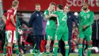 Ireland's Seamus Colman celebrates with James McClean after beating Austria in their 2018 World Cup qualifier in Vienna. Photo: Ryan Byrne/Inpho