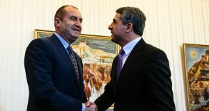 Bulgarian president Rosen Plevneliev (right) shakes hands with president-elect Rumen Radev prior to their meeting at the Bulgarian presidency office in Sofia on November 14th, 2016. Photograph: Dimitar Dilkoff/AFP/Getty Images