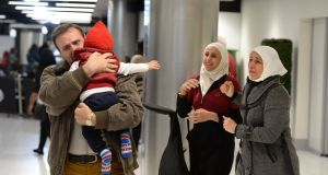 Samir Youzbashi Aljafari and his wife Wafaa, Syrian refugees living in Killarney, are reunited with their  daughter Nadine (21)  and  grandson Yousef (1) after they arrived in Dublin Airport from Damascus. Photograph: Dara Mac Donaill