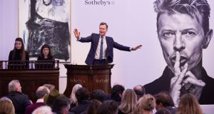 Sotheby's auctioneer Oliver Barker fields bids at the  sale of David Bowie's art collection. Photograph: Michael Bowles/Getty Images