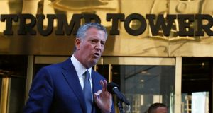 New York City mayor Bill de Blasio: tells reporters  he let Donald Trump know that many New Yorkers are fearful of  his future policies. Photograph: Brendan McDermid/Reuters