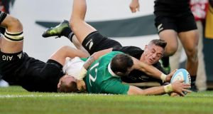 Ireland beat the All-Blacks: rugby triumphs provide cold comfort as RTÉ presenters discuss the Trump economy. Photograph: Dan Sheridan/Inpho