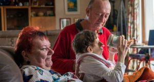 Siobhan, pictured with her parents Johanne and Alan, goes to bed at 4.30pm every day. Photograph: Brenda Fitzsimons