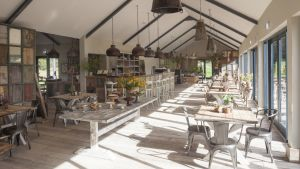 The Green Barn is a  wooden building with a Scandi-shabby feel