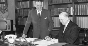 Taoiseach  Séan Lemass and president Éamon DeValera signing the proclamation to dissolve Dáil Éireann in March 1965. Photograph:  INM/Getty Images