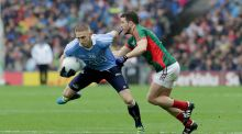 Eoghan O'Gara in action against Chris Barrett of Mayo in the All-Ireland final. The Dublin forward had to contend with limited playing time this year.  Photograph: Morgan Treacy/Inpho
