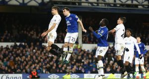 Séamus Coleman heads home a late equaliser in the Premier League game against Swansea   at Goodison Park. Photograph: Jan Kruger/Getty Images