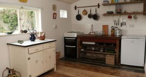 "Will's favourite room is the kitchen. ""We improvised it. A friend gave us a Belfast sink and salvaged us a table,"" he says. Photo: Lorraine Teevan"