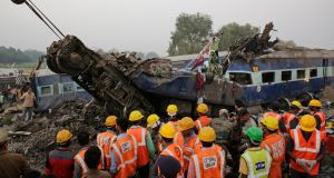 Rescue workers at the site of an accident where coaches of an Indore-Patna Express train derailed, near Pukhrayan, in Kanpur, India on Sunday. Photograph: Rajesh Kumar Singh/AP