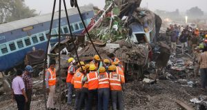 Rescue workers at the site of an accident where coaches of an Indore-Patna Express train derailed, near Pukhrayan, in Kanpur, India on Sunday. Photograph: EPA