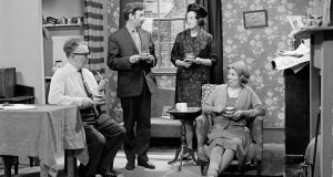 A scene from the RTÉ Television drama series Tolka Row, during studio filming in 1967. From left to right; John McDarby as Gabby Doyle, Des Perry as Jack Nolan, May Ollis as Rita Nolan and Iris Lawler as Statia Nolan-Doyle.  It ran from  January 3, 1964 to  June 7, 1968.