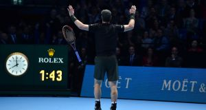 Andy Murray celebrates winning the men's singles final against Serbia's Novak Djokovic on the eighth and final day of the ATP World Tour Finals. Photograph: Getty Images