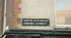 Coburg Street in Cork city, which has an entirely unrelated name, Sráid Uí h-Uigín (O'Higgins' Street), in the Irish language