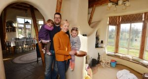 Paul and Therese Dillon and children inside their cob house near Nenagh, Co Tipperary. Photograph: Alan Betson