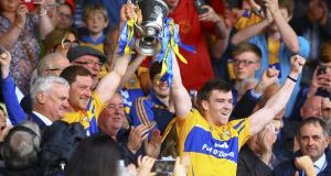 Clare captains Cian Dillon and Tony Kelly lift the cup after their side beat Tipperary in the Allianz League Division One Hurling Final last year. Photo: Getty Images