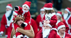 Santa dash: some locations even host  a special Christmas Day event, Photograph: Nick Ponty