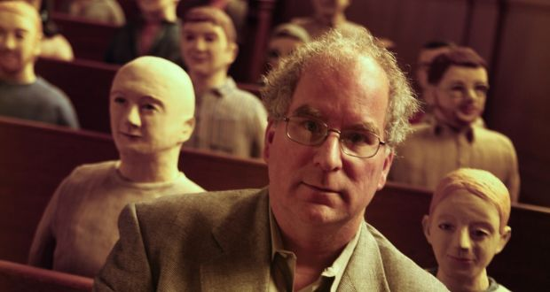 "Brewster Kahle, founder and digital librarian of the San Francisco-based nonprofit Internet Archive, sitting with sculptures of ""clay librarians"".  Photograph: Mark Boster/Los Angeles Times via Getty"