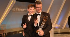 EY International Entrepreneur of the Year and overall winner of the Entrepreneur of the year award 2016, Brendan Mooney of Kainos with his son Odhran. Photograph: Alan Betson
