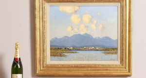 """Cottages, Connemara"" by Paul Henry   (€120,000-€180,000)  is photographed beside a bottle of champagne   to show bidders the scale of the painting"