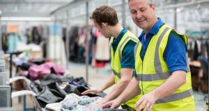 Each worker at  the I:CO London factory sorts an average of 2,800kg of clothes a day