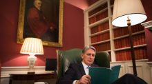 British chancellor of the exchequer Philip Hammond looks over his autumn statement in his office at 11 Downing Street  on Wednesday. Photograph: Stefan Rousseau/AFP/Getty Images