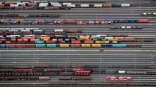 Containers and cars are loaded on freight trains at the railroad shunting yard in Maschen near Hamburg