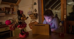 Coral Collier, who has a mental health condition, epilepsy,  insomnia and mostly uses a wheelchair, spends most of her time with her iPad listening to music and watching cartoons. Photograph: Brenda Fitzsimons