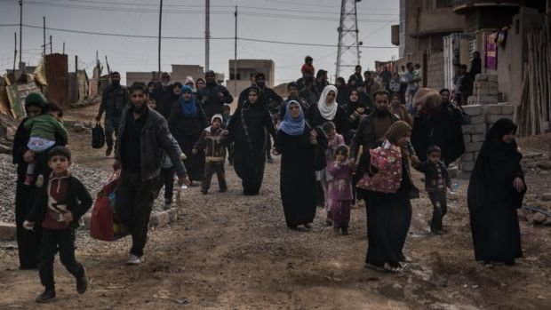 Residents of Mosul leave the city as the assault on Islamic State by coalition forces intensifes. Photograph: Sergey Ponomarev/New York Times