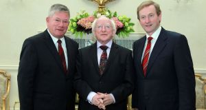 Mr Justice Raymond Groarke taking office as President of the Circuit Court in 2012 with President Michael D. Higgins and Taoiseach Enda Kenny. Photograph: Maxwells