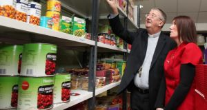 Archbishop of Dublin Diarmuid Martin at the Crosscare food bank talking with foodbank manager Valerie Cummins in 2013. File photograph: John McElroy