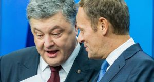 "Petro Poroshenko with European Council president Donald Tusk on Thursday: The Ukrainian president described a trade agreement with the EU as ""a symbol of the fight of our country for our European future"".  Photograph: EPA/Stephanie Lecocq"