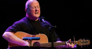 Christy Moore: Iarla Ó Lionaird cites his version of I Pity the Poor Immigrant by Bob Dylan; Tony Barrett his cover of Jimmy McCarthy's Missing You. Photograph: Matt Kavanagh