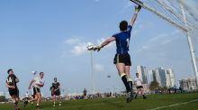 Michael Murphy of the 2016 All Stars sees his shot  punched over the bar by 2015 All Stars goalkeeper David Clarke at the Sheikh Zayed Sports City Stadium. Photograph: Ray McManus/Sportsfile