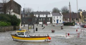 The flooded quayside at Kinvara, Co Galway, during the 2013-2014 winter storms. File photograph: Joe O'Shaughnessy