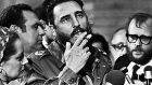 Fidel Castro smokes a cigar during interviews with the press during a visit of US Senator Charles McGovern, in Havana in May 1975. File photograph: Prensa Latina/Reuters