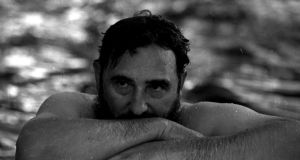Fidel Castro relaxes in a swimming pool during a visit to Romania in  this May  1972 file photograph. Photograph: Reuters