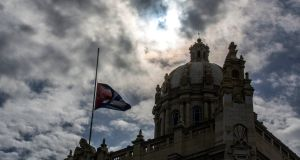 The Cuban flag flies at half-mast outside the Museum of the Revolution. Photograph: AP