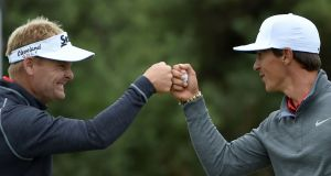 Thorbjorn Olesen and Soren Kjeldsen celebrate making a birdie during the final round of the World Cup of Golf on the Kingston Heath course in Melbourne. Photograph: Getty Images
